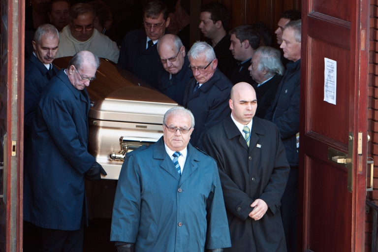 <p>Pallbearers bring the casket of Mafia kingpin Nicolo Rizzuto Sr. out of the Notre-Dame-de-la-Defense church in Montreal, Canada Nov. 15, 2010 following his funeral. Secret police videos of the 86-year-old patriarch collecting money from various figures have linked him to several lucrative construction projects and revealed corruption within Montreal's government.</p>