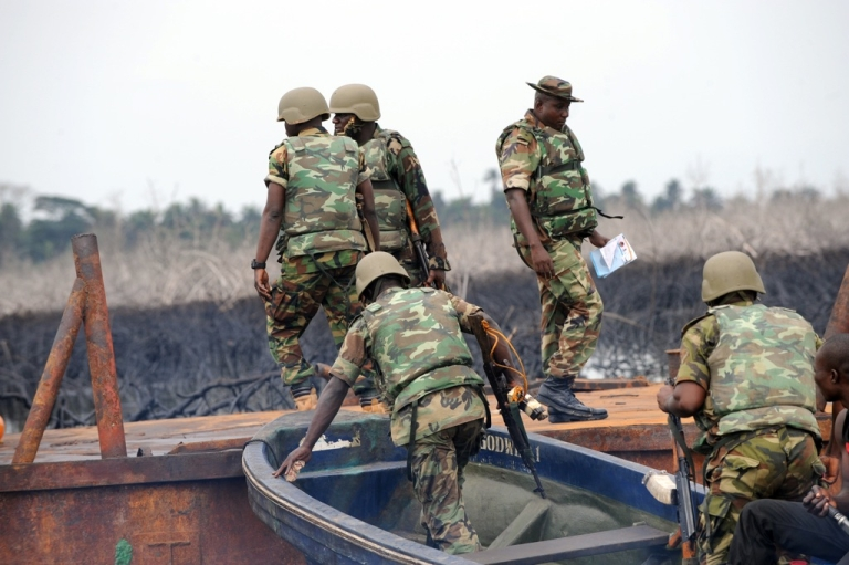 <p>The Joint Take Force inspects a barge seized from oil thieves at Bodo waterways, Ogoniland in Rivers State on April 12, 2011.</p>