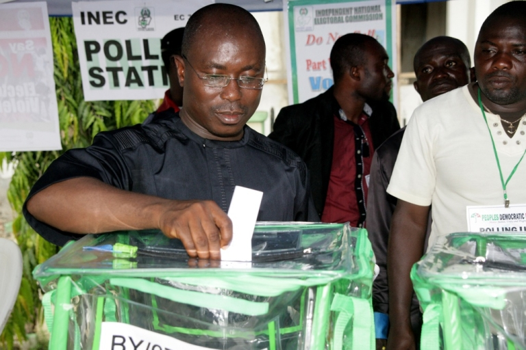 <p>A Nigerian casts his vote at a polling station in Otueke during parliamentary polls on April 9, 2011.</p>