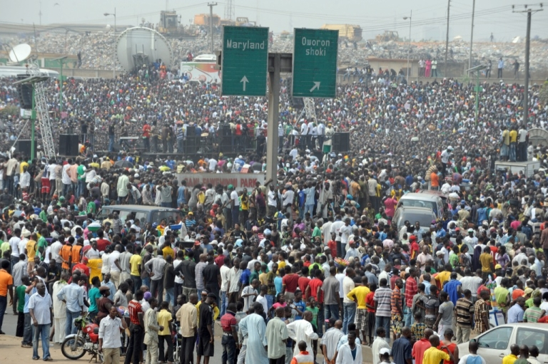 <p>People gather during a protest against the scrapping of oil subsidy at Gani Fawehinmi Park, Ojota in Lagos on Jan. 12, 2012. Nigerian oil workers vowed Thursday to begin shutting down production of Africa's top crude exporter, piling intense pressure on the government ahead of talks on the fourth day of a nationwide strike.</p>