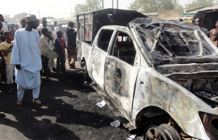 <p>A resident inspects a police patrol van outside Sheka police station in northern Nigerian city of Kano on January 25, 2012. The van was burnt in bomb and shooting attacks on the police station the previous night by around 30 members of Boko haram Islamists group. Although responsible for similar attacks, many have speculated that Boko haram is not responsible for yesterday's prison raid.</p>