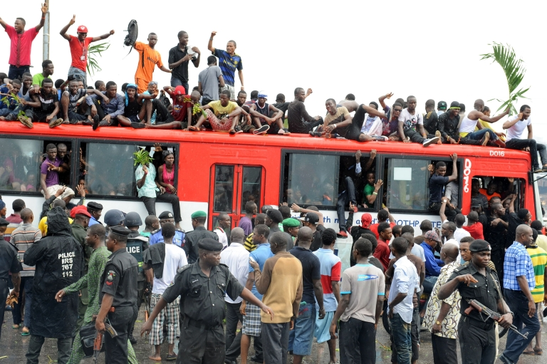 <p>Students at the University of Lagos sit on a bus on the Third Mainland bridge in Lagos to protest the decision to change the name of the institution to Moshood Abiola University.</p>