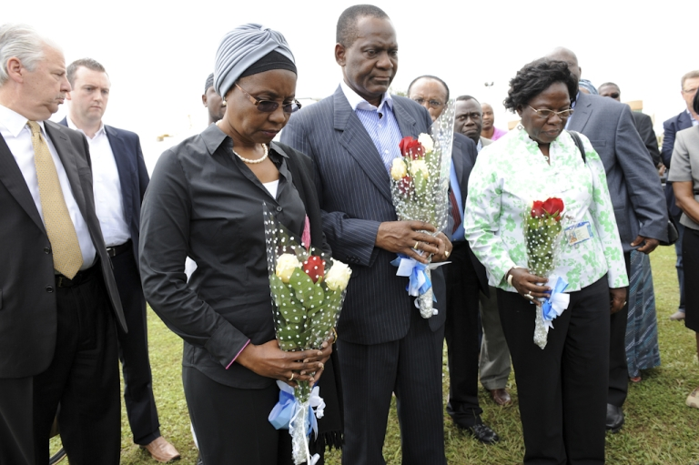 <p>Deputy Secretary General of the United Nations Asha-Rose Migiro (L) accompanied by Nigerian Foreign Affairs Minister Ambassador Olugbenga Ashiru (C) and Deputy Resident Coordinator of UN in Nigeria, Dr. Agathe Lawson tries to lay a wreath in honour of the dead at the compound of the United Nations building rocked by bomb blast in Abuja on August 28, 2011. The Islamist sect known as Boko Haram has claimed responsibility for the bombing.</p>