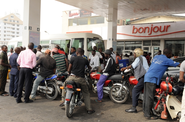 <p>Motorcycle taxis queue to buy fuel at a Total filling station in Lagos on January 17, 2012. Many filling stations in Lagos  and other parts of the country are short of supplies, with long lines for gasoline. Others are out of fuel entirely.</p>