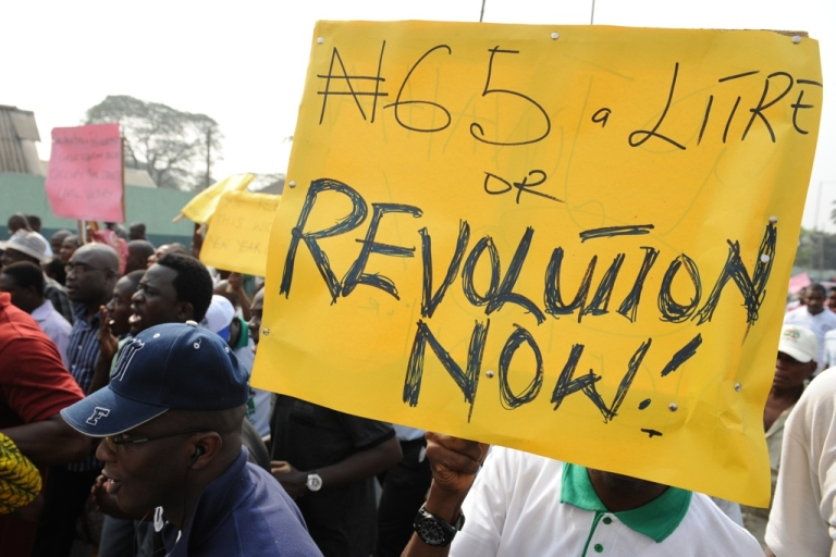 <p>Nigerian union members and demonstrators march in Lagos to protest the removal of petroleum subsidies by the government on January 3, 2012. Nigerian police fired tear gas to disperse a small crowd burning tires in Lagos and arrested demonstrators in the northern city of Kano on Tuesday as protests continued over soaring fuel prices.</p>