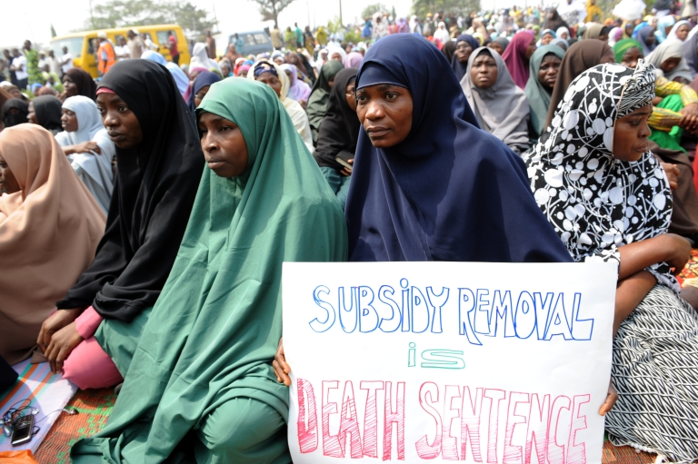 <p>Muslim women hold placards during Friday prayers today in Lagos, Nigeria.  The protest is against the cancellation of a fuel subsidy that has sent prices soaring and sparked protests that are scheduled to resume Monday.</p>