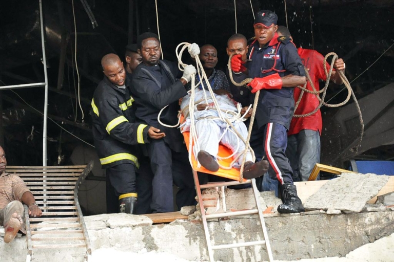 <p>Rescue workers evacuate on August 26, 2011 a wounded man from the UN building of the Nigerian capital Abuja which was rocked by a bomb that killed at least 18 people, leaving others trapped and causing heavy damage. The attack by radical Islamist sect Boko Haram marked a significant escalation in the violence.</p>