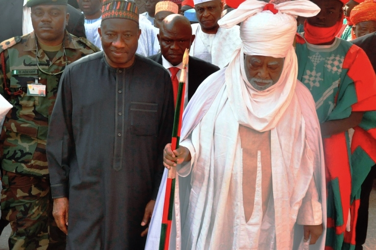 <p>Nigerian President Goodluck Jonathan (L) walks with the Emir of Kano Ado Bayero at the emir's palace on Jan. 22, 2012 in Kano during a one-day visit to the city that was rocked by multiple explosions and shootings two-days ago. President Goodluck Jonathan visited Nigeria's second largest city of Kano on Sunday after at least 166 people were killed in one of the deadliest waves of attacks in the mainly Muslim north.</p>