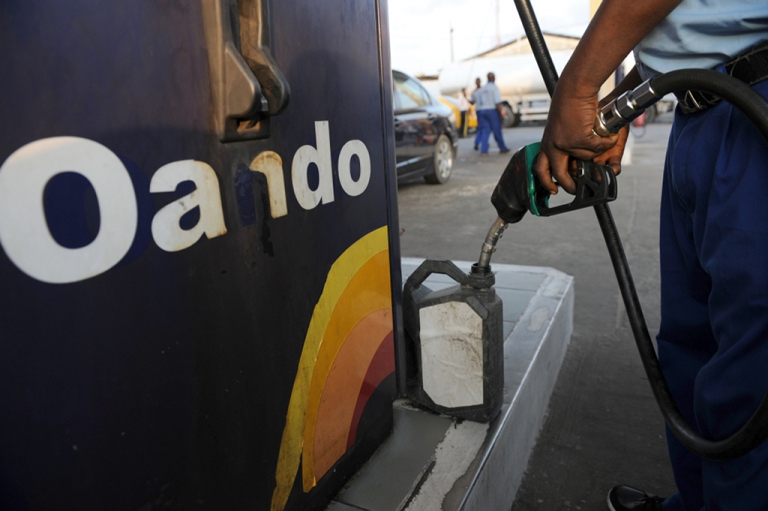 <p>An attendant sells fuel in a jerry can at a filling station in Lagos on November 10, 2011.</p>