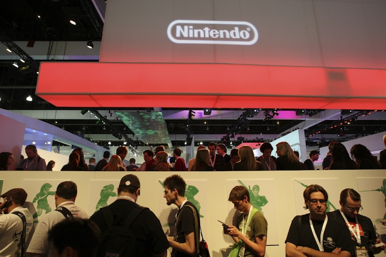 <p>Long lines form to try new games in the Nintendo exhibit in the annual Electronic Entertainment Expo (E3) at the Los Angeles Convention Center on June 16, 2010 in Los Angeles, California.</p>