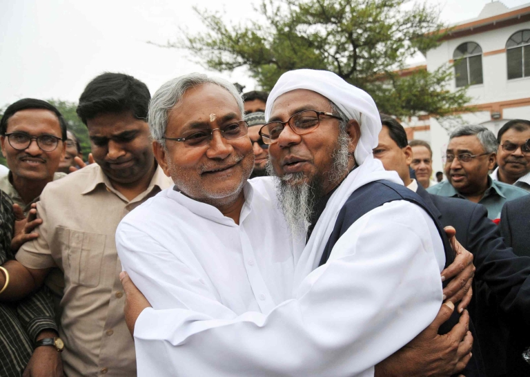 <p>A man congratulates Bihar's Chief Minister Nitish Kumar (L) at his residence in Patna on November 25, 2010. Kumar's party is a vital partner in the Bharatiya Janata Party's (BJP) National Democratic Alliance (NDA). But in recent days he has threatened to pull out if the BJP projects Gujarat's Narendra Modi as its candidate for prime minister.</p>