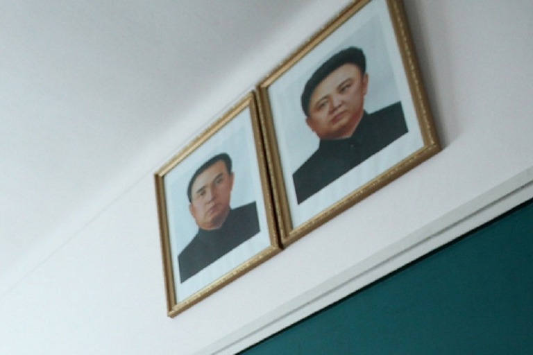 <p>Images of North Korea's founding father Kim Il-Sung and his son Jong-Il are hung in homes, offices and public buildings across North Korea.</p>