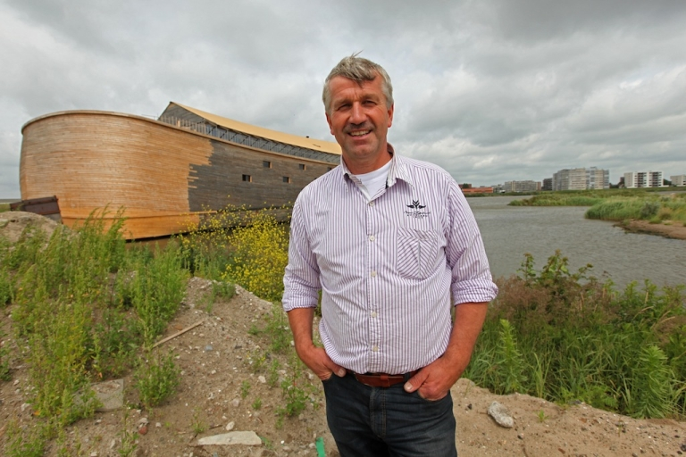 <p>Dutch artist Johan Huibers poses next to the 150 metre-long Noah's ark he created at an old abandoned quay on the Merwede River in Dordrecht on June 21, 2011. For the last three years the quaint old Dutch city of Dordrecht have been watching in amazement as construction businessman Johan Huibers' dream of building a 150 metre-long Noah's ark, stocked with thousands of plastic animals, slowly grew into a reality.</p>