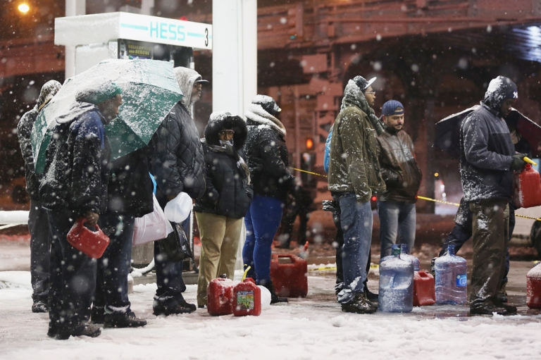 <p>People wait on line to buy gasoline during a Nor'Easter snowstorm on November 7, 2012 in the Brooklyn borough of New York City. The city is still experiencing long gas lines in the wake of Superstorm Sandy.</p>