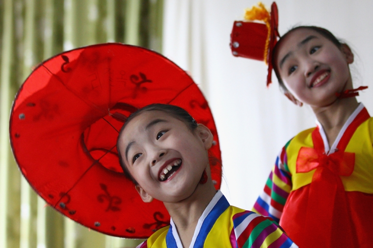 <p>North Korean children perform in a primary school on April 2, 2011 in Pyongyang, North Korea.</p>