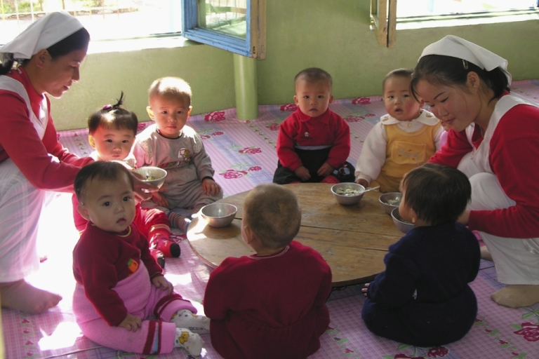 <p>China is shipping rice to North Korea, where malnutrition for children is still high. Here, children attend a nursery with special food provided by the World Food Program in Pyongyang.</p>