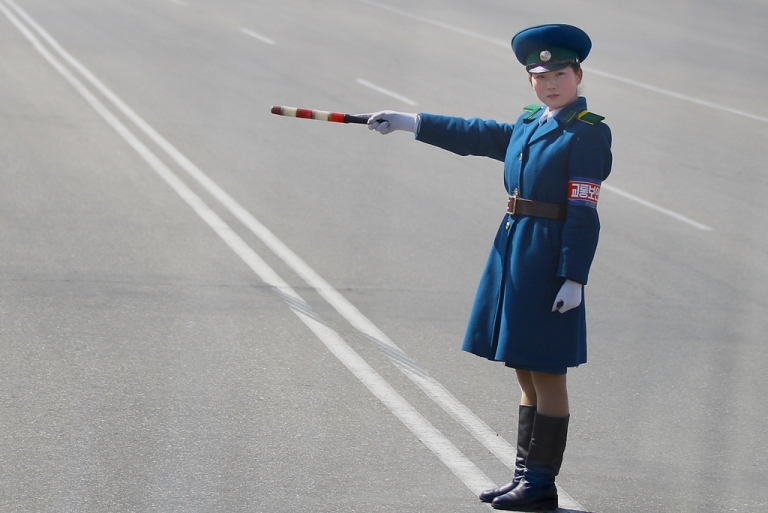<p>A young police woman conducts the traffic on April 3, 2011 in Pyongyang, North Korea.</p>