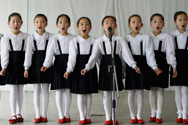 <p>North Korean children perform in a primary school on April 2, 2011 in Pyongyang, North Korea. Pyongyang is the capital city of North Korea and the population is about 2,500,000.</p>