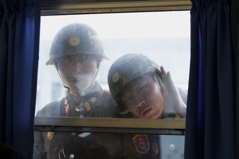 <p>North Korean soldiers look in from outside the U.N. Command Military Armistice Commission meeting room at the border village of Panmunjom in the Demilitarized Zone (DMZ) that separates the two Koreas since the Korean War, in Paju, north of Seoul, on April 24, 2011.</p>