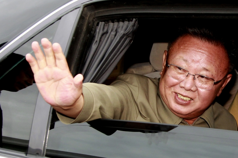 <p>North Korea's leader Kim Jong Il waves his hand from a car after meeting with Russian President Dmitry Medvedev in Buryatia outside Ulan-Ude on Aug. 24, 2011.</p>