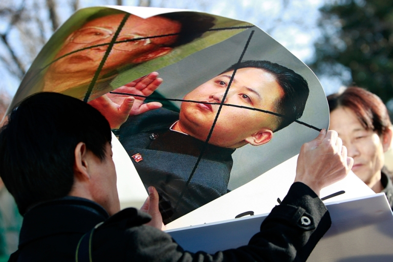 <p>North Korean defectors hold defaced posters of North Korea leader Kim Jong Il and his son Kim Jong Un as they participate in an anti-North Korea protest in front of the South Korean Defense Ministry on Nov. 29, 2010 in Seoul.</p>
