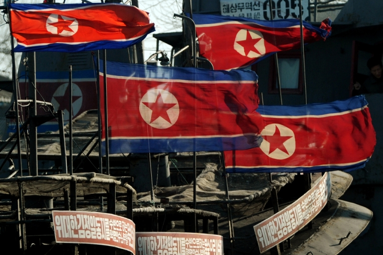 <p>North Korean flags fly at half-mast on fishing boats after the funeral of the late leader Kim Jong Il, at the Chinese North Korean border area near Dandong on Dec. 29, 2011.</p>