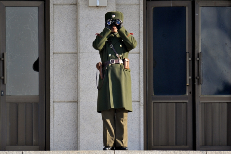 <p>A North Korean soldier looks at the South side at the truce village of Panmunjom in the Demilitarized Zone separating the two Koreas on January 19, 2011.</p>