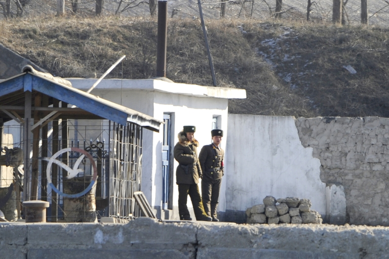 <p>North Korean soldiers stand guard along the bank of the Yalu River in the North Korean town of Sinuiji, on Dec. 22, 2011.</p>