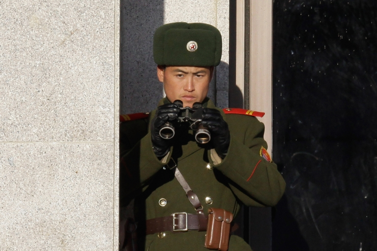 <p>A North Korean soldier looks at South Korea across the Korean Demilitarized Zone (DMZ), on Dec. 22, 2011 in Panmunjom, South Korea.</p>