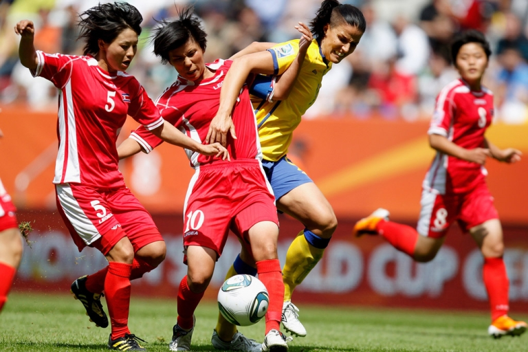 <p>Yun Mi Jo (center) and Jong Sun Song (left) of North Korea battle for the ball with Sweden's Jessica Landstrom (right), during a FIFA Women's World Cup 2011 Group C match in Augsburg, Germany, on July 2, 2011.</p>