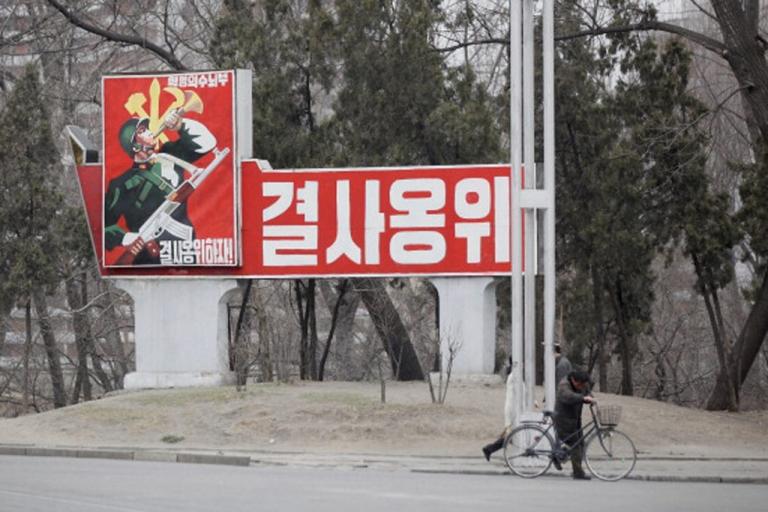 <p>A propaganda poster is seen on April 3, 2011 in Pyongyang, North Korea.</p>