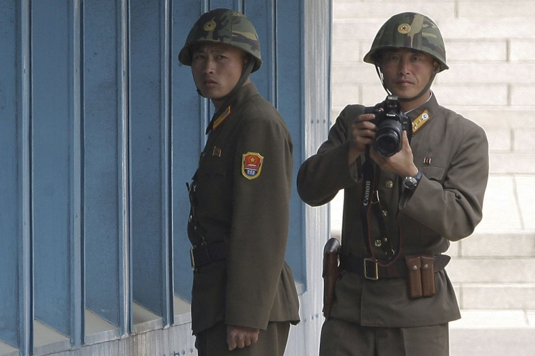 <p>North Korean soldiers watch as Prince Frederik and Princess Mary of Denmark (not pictured) visit the border village of Panmunjom in the demilitarized zone on May 13, 2012.</p>