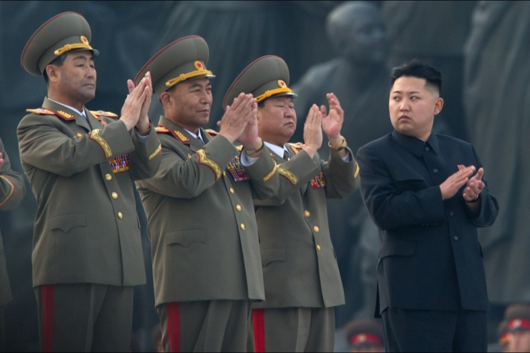<p>North Korean leader Kim Jong-Un (R) claps as he attends the unveiling ceremony of two statues of former leaders Kim Il-Sung and Kim Jong-Il in Pyongyang on April 13, 2012. North Korea's new leader Kim Jong-Un on April 13 led a mass rally for his late father and grandfather following the country's failed rocket launch.</p>
