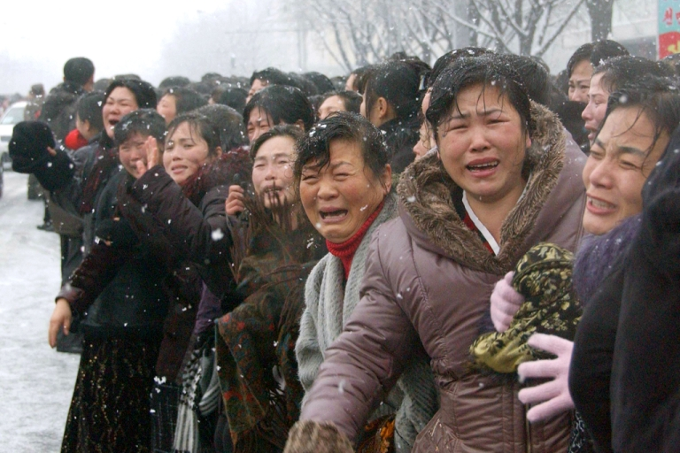 <p>In this photo taken on December 28, 2011 mourners react as a car Kim Jong-Il's body passes by during the funeral procession in Pyongyang.         AFP PHOTO / KYODO</p>
