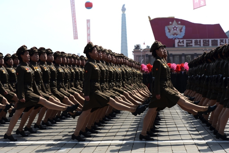 <p>North Korean female soldiers march during a military parade to mark 100 years since the birth of the country's founder Kim Il-Sung in Pyongyang on April 15, 2012. The commemorations came just two days after a satellite launch timed to mark the centenary fizzled out embarrassingly when the rocket apparently exploded within minutes of blastoff and plunged into the sea.</p>