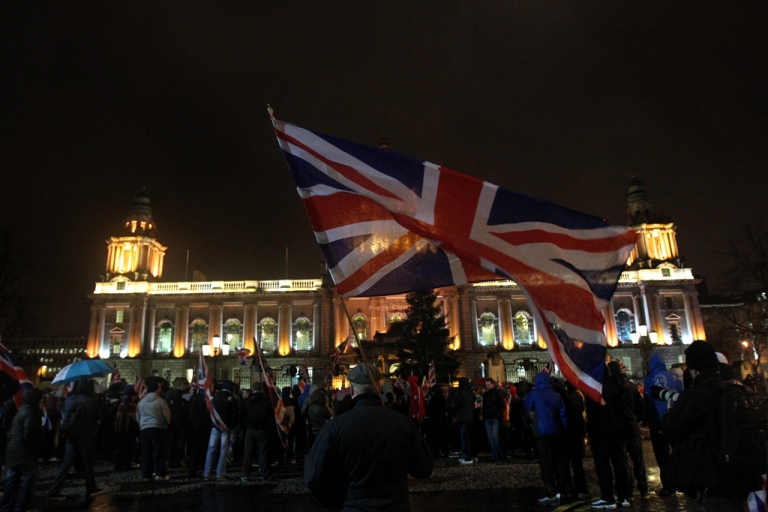 <p>Loyalist protesters gather at Belfast City Hall during a city council meeting in Belfast, Northern Ireland on January 7, 2013.</p>
