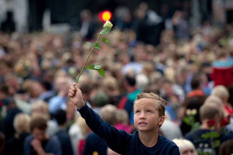 <p>A boy holds a rose as hundreds of thousands of people gathered at a memorial vigil on July 25, 2011 in Oslo, Norway following attacks July 22 in Oslo and on Utoya Island.</p>
