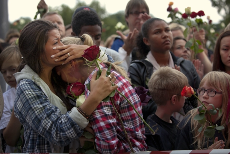 <p>Mourners comfort each other at a memorial vigil in July, following attacks by Anders Behring Breivik.</p>