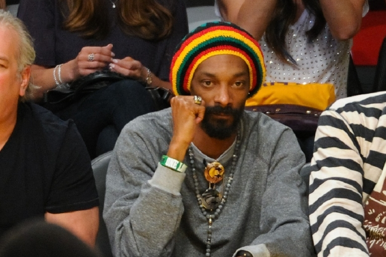 <p>Snoop Dogg, pictured here at the LA Lakers and Oklamhoma City Thunder game on May 18, was stopped at an airport in Norway reportedly carrying a small amount of marijuana and too much cash.</p>