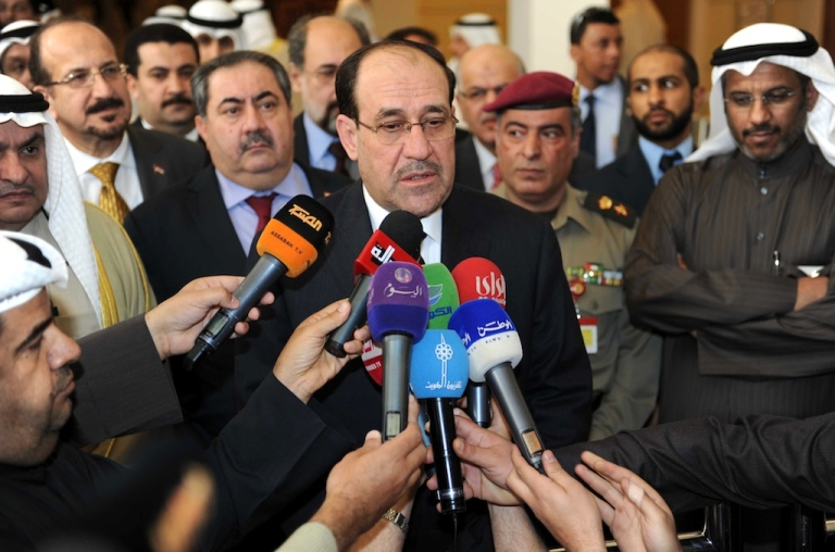 <p>Iraqi Prime Minister Nouri al-Maliki (C) speaking to reporters during his visit to Kuwait's National Assemly in Kuwait City on March 14, 2012.</p>