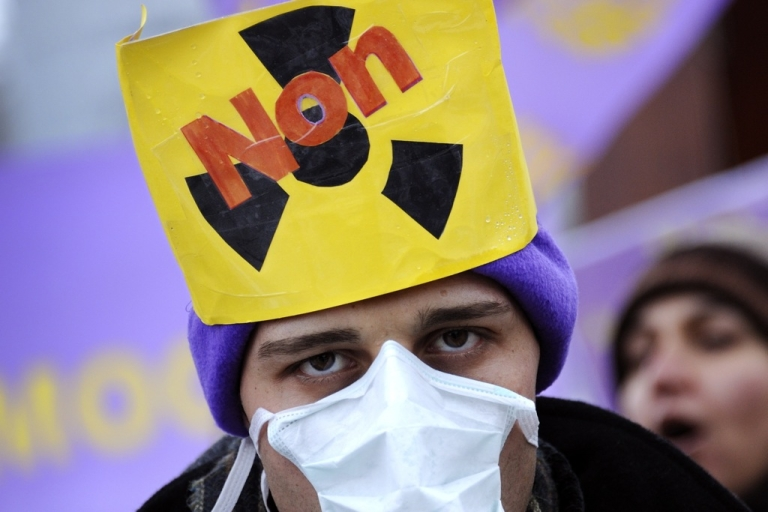 <p>A sign reading 'No to Nuclear' protests is worn by an Iranian opposition protester in Geneva as world powers met with Iran over its controversial nuclear program in December 2010.</p>