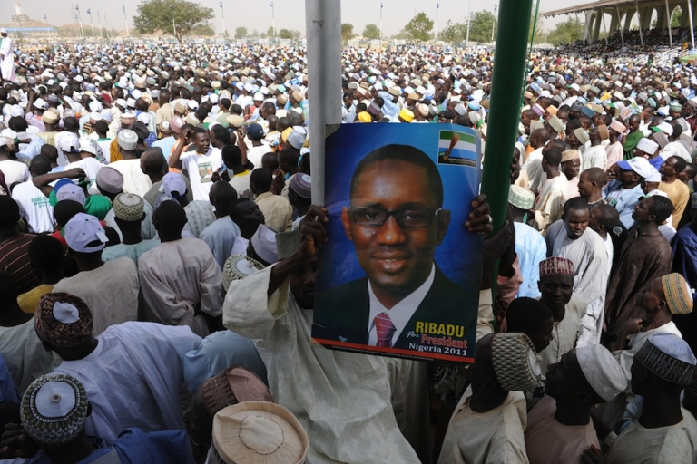 <p>At a rally in Dutse, Jigawa a party supporter holds a poster of then presidential candidate Nuhu Ribadu on Feb. 28, 2011.</p>