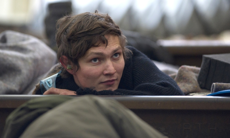 <p>An anti-nuclear protester lies on the railroad tracks near Vastorf, Germany, on Nov. 27, 2011, in an effort to block the nuclear waste transport train due to pass there.</p>