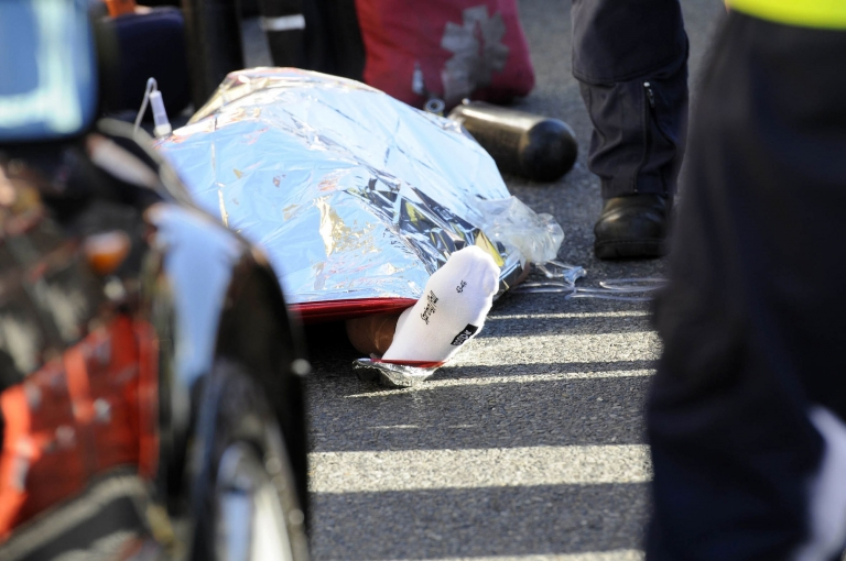 <p>South African paramedics gather around the lifeless body of Italian chocolate tycoon Pietro Ferrero after he died while riding his bike on the outskirt of Cape Town on April 18, 2011. Ferrero, who was 47, fell from his bicycle during a regular riding session, probably because he was taken ill, while on a business trip in South Africa.</p>