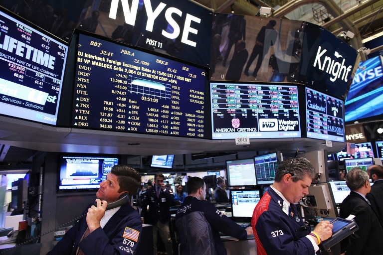 <p>Traders work on the floor of the New York Stock Exchange in New York City on May 1, 2012.</p>
