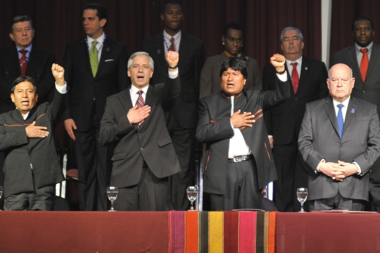 <p>Bolivian President Evo Morales, second from right, sings his national anthem next to OAS Secretary General Jose Miguel Insulza, right.</p>