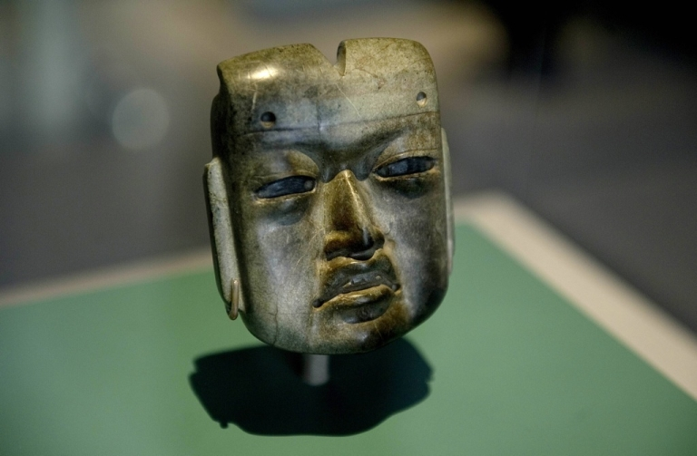 <p>Tourism officials want the world to know that Mexico offers far more than beaches. Here, a hornblende piece called 'The Mask' with influence of the Olmeca culture dating back from around 1470 DC and found in the border between the Mexican states of Guerrero, Puebla and Oaxaca, is displayed at the Museum of Anthropology in Mexico City on July 20, 2011.</p>