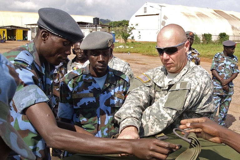 <p>US soldiers assist Ugandan Airforce personnel at a military airbase in Entebbe, Uganda. The food supplies were destined for frontline Ugandan troops hunting rebel group, The Lord's Resistance Army (LRA). US Presdient Barack Obama has deployed 100 special forces soldiers to help track down LRA Chief and international fugitive Joseph Kony who has been active across four countries in the region for over two decades.</p>