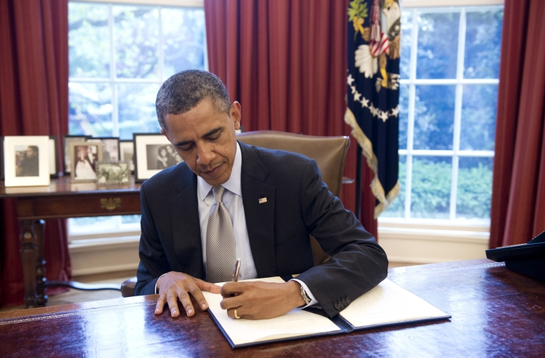 <p>US President Barack Obama signs a proclamation designating Fort Ord, a former military base in California, as a national monument on April 20, 2012.</p>