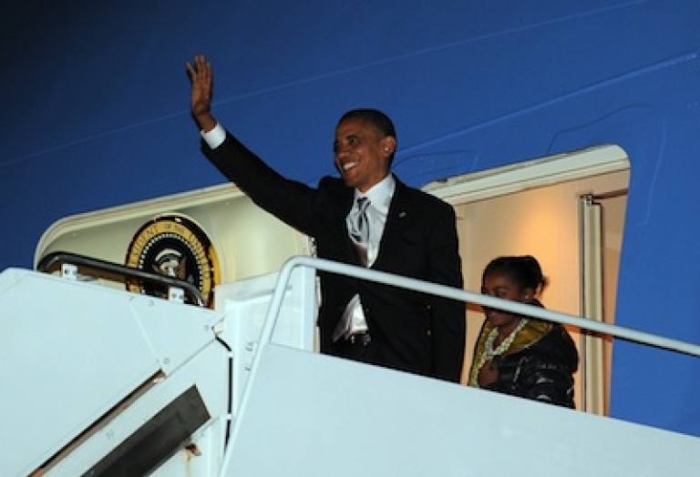 <p>President Barack Obama waves as he disembarks from Air Force One on November 7, 2012.</p>
